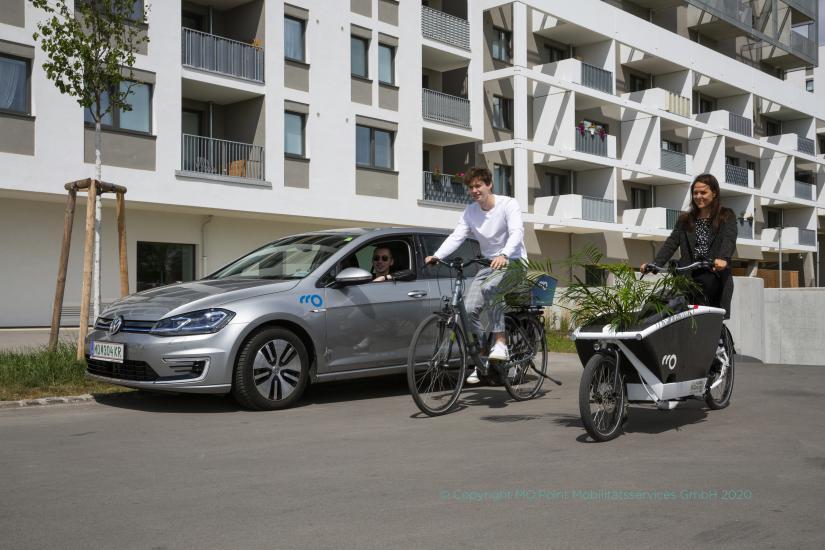 Fahrrad, Lastenrad und Auto in E-Qualität